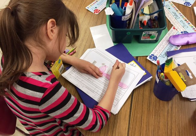 Student working on reading papers
